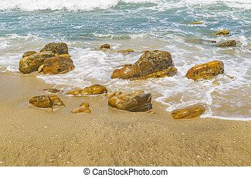 Rocks at shore in Praia Malhada beach at Jericoacoara Brazil