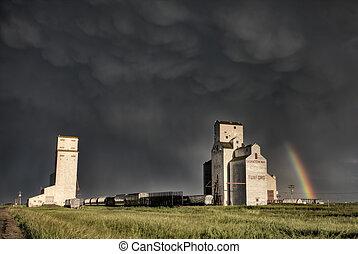 Prairie Grain Elevator in Saskatchewan Canada with storm...