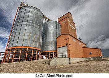 Prairie Grain Elevator in Saskatchewan Canada with storm clouds