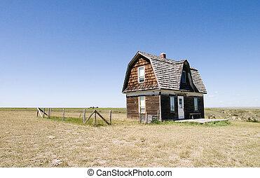 Prairie Homestead - A prairie homestead house on a skyless...