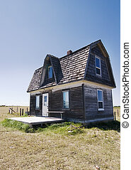 Prairie Homestead - An old prairie house on a grass meadow...
