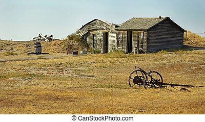 Prairie Homestead Historic Site in South Dakota displaying an original pioneer dirt sod home constructed in 1909 on the edge of the Great Plains in the USA