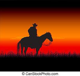 prairie night - cowboy sitting on a horse on the prairie