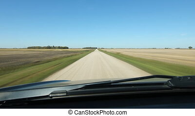 Prairie road time lapse. Manitoba. - Driving on a white...