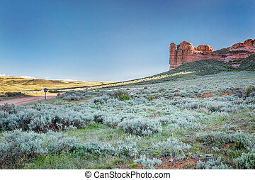 prairie, shrubland and sandstone rock formation in northern ...