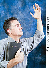 Praise God! - A man in a posture of praise and worship with...