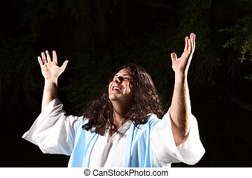 Praise the Lord - A man dressed in robe hands raised in the...