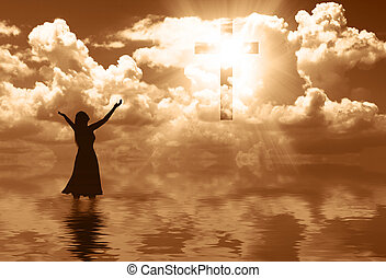 Praising - A woman praising the cross in the clouds