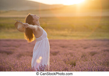 Praising the beauty of life - Beautiful young woman with a...