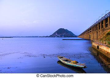 Prakasam Barrage bridge in India under morning sunlight
