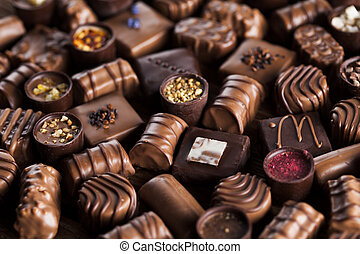 Praline Chocolate on wooden backgroud - Chocolate bars and...