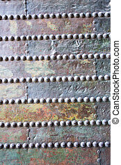Prallel nails in a wooden door