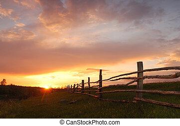 pramen, západ slunce
