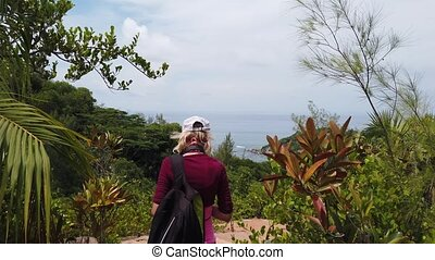 Praslin third person view trekking - Third person view of...