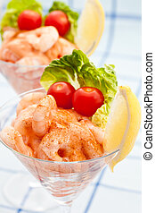 Prawn cocktail appetizer with small tomatoes and fresh lemon...