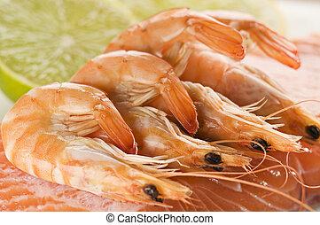 Prawn - Raw and fresh salmon steak with prawns close up