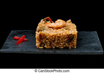 Prawn rice. - spanish rice with prawn and vegetables served...