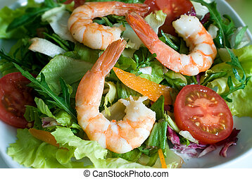 Prawn salad with mixed greens, tomatoes, peppers and...