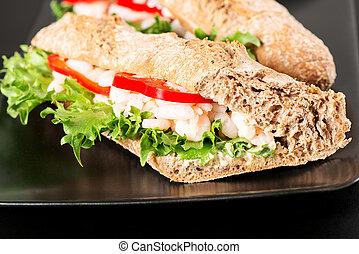 Prawn sandwich on black plate