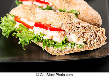 Prawn sandwich on black plate
