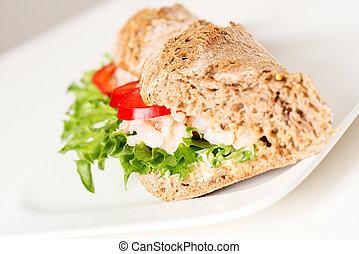 Prawn sandwich on white plate angled