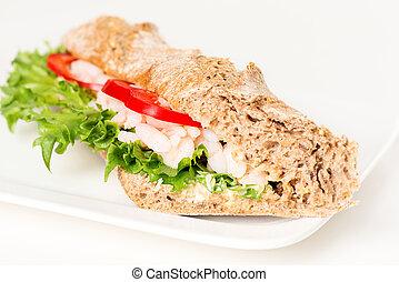 Prawn sandwich on white plate closeup