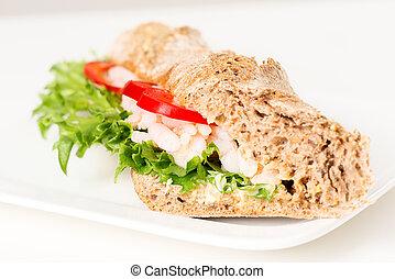 Prawn sandwich on white plate