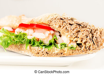 Prawn sandwich on white plate