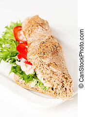 Prawn sandwich on white plate vertical angled