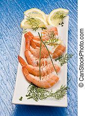 Prawns appetizer - photo of delicious raw prawns with lemon ...