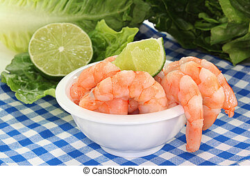 Prawns - fresh shrimp and lime on a white background