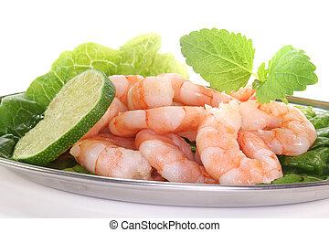 Prawns - fresh shrimp with lime, lemon balm and lettuce on a...