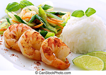 Grilled prawns with rice and vegetable on a white dish.