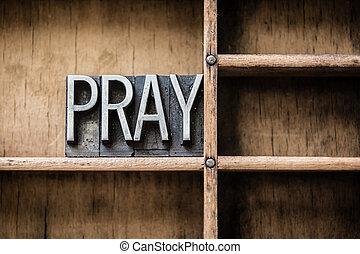 Pray Letterpress Concept - The word PRAY written in vintage...