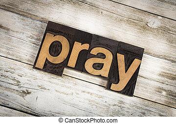 Pray Letterpress Word on Wooden Background
