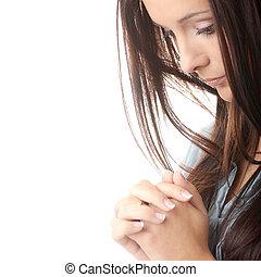 Pray - Closeup portrait of a young caucasian woman praying...