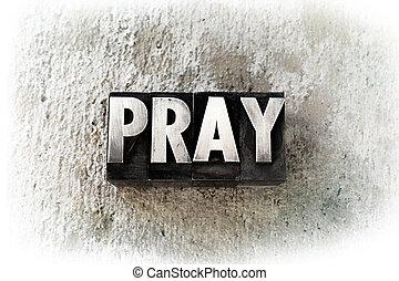 """The word """"PRAY"""" written in old vintage letterpress type."""