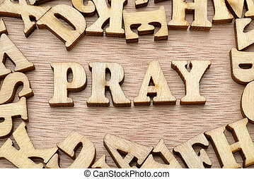 Pray word made with wooden letters