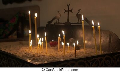 Prayer altar with candles orthodox church interior slow motion