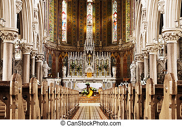 Golden light of God - Easter altar in a beautiful Christian church. The shot was taken inside The Church of The Sacred Heart and Saint Catherine of Siena in Newry, Northern Ireland.