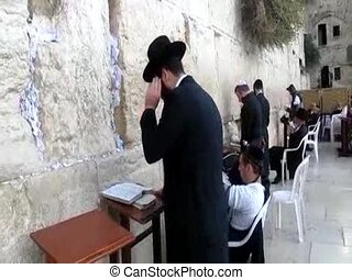 Prayer at the holy Western Wall , Jerusalem, Israel