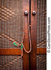 Prayer beads - Wooden islamic prayer beads hanging on a door...