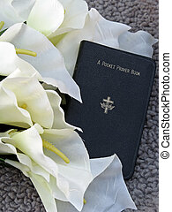 prayer book and silk calla lily