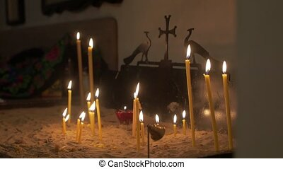 Prayer candles in the temple orthodox church interior slow motion