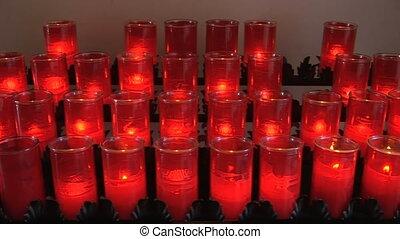 Rows of burning prayer candles at San Juan Capistrano
