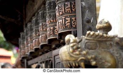 Prayer drums in Swayambhunath - Hands untwist prayer drums...
