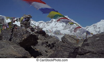 Prayer flags against the background of the Himalayan mountains.