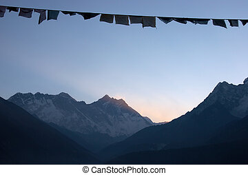 Prayer flags at sunrise, Himalaya mountains, Nepal