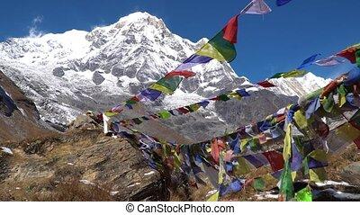 Prayer flags on Annapurna Basecamp, Nepal. Annapurna peak in...