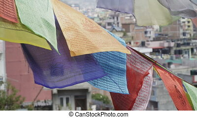 Prayer flags on the background of Kathmandu houses -...
